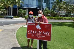 DSC_3736 Calvin K.Y. Say sign wavers